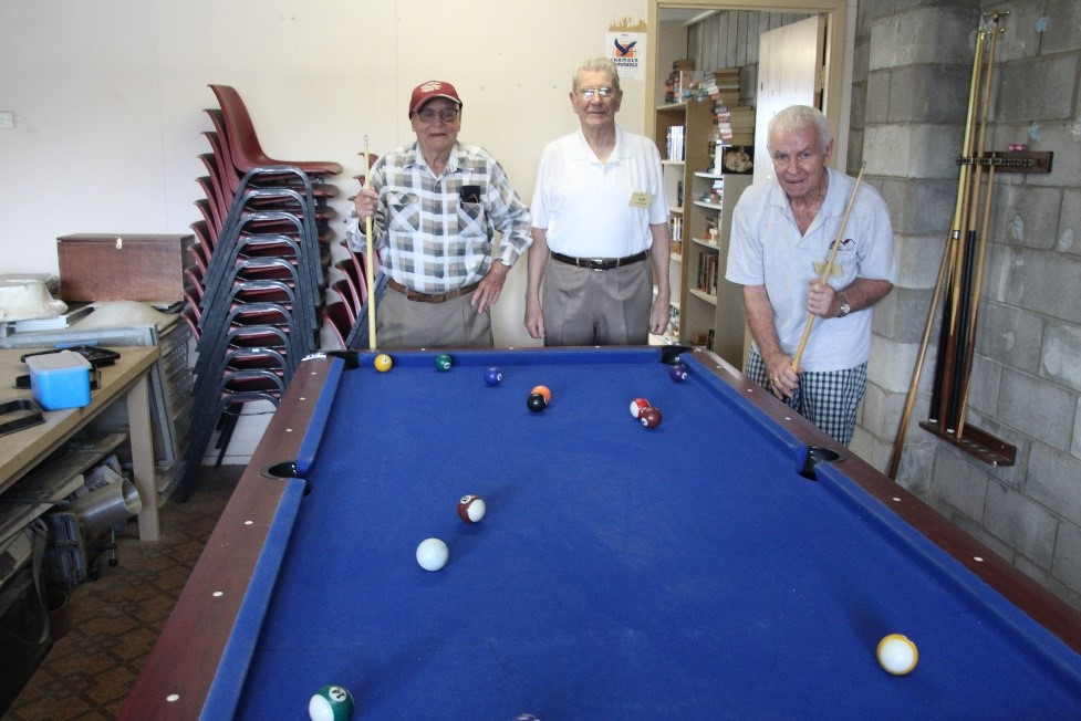 Mens Shed Playing Pool